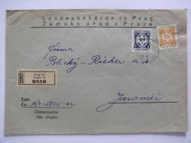 Dopis se služebními známkami.